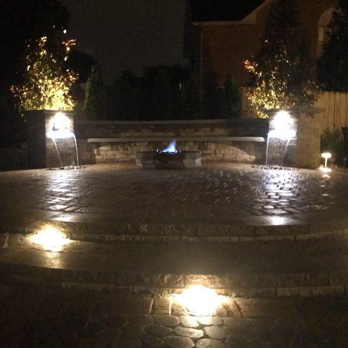 Night Lighting with Fire Pit and Water Feature
